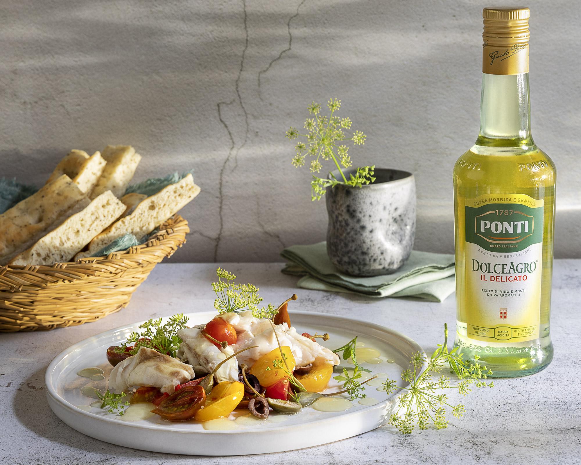 Cernia al forno con pomodori olive taggiasche capperi origano e agro - Ponti