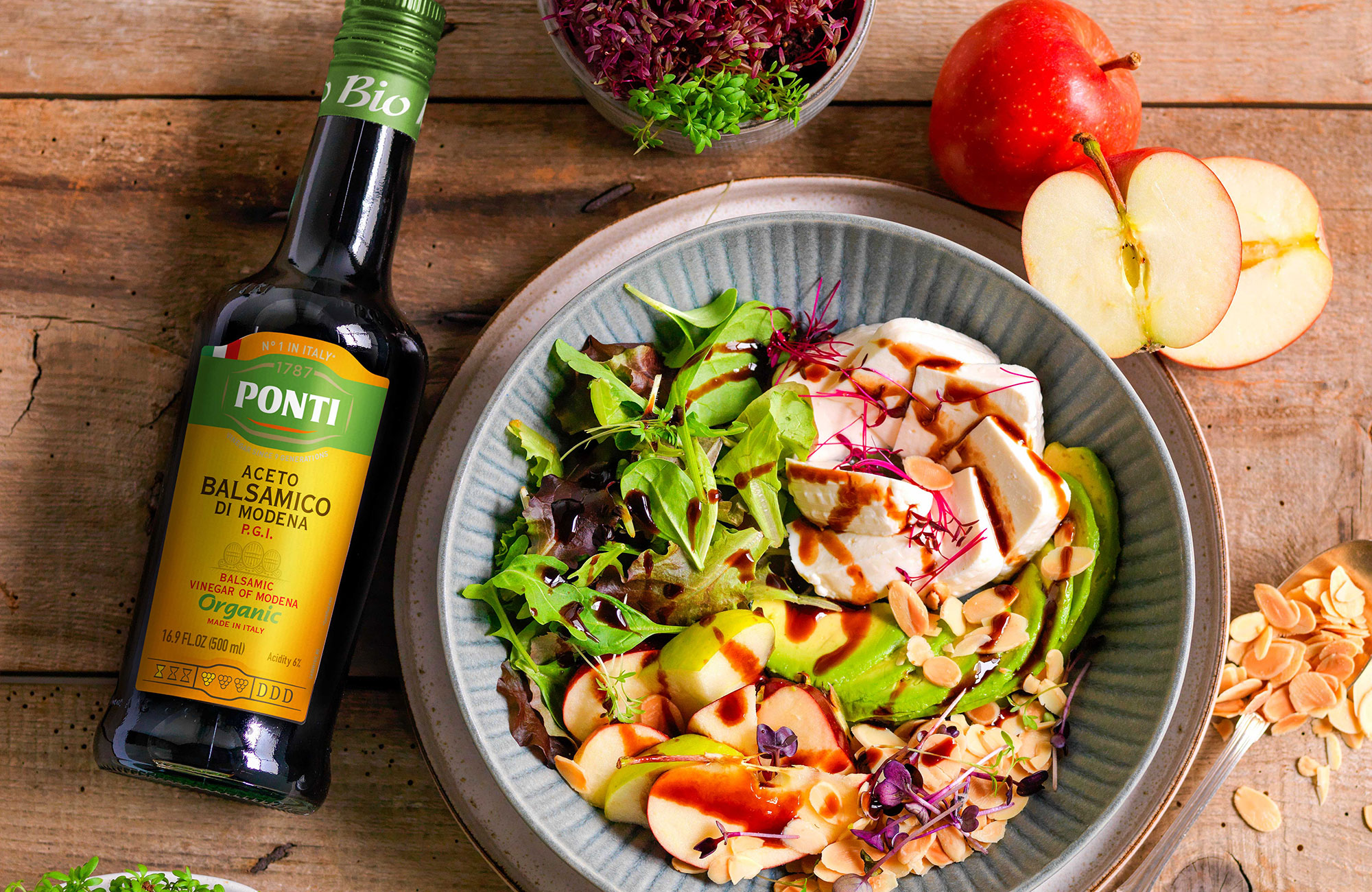 Mixed salad with avocado, Asiago P.D.O. and garnished with Ponti Organic Balsamic Vinegar of Modena P.G.I - Ponti