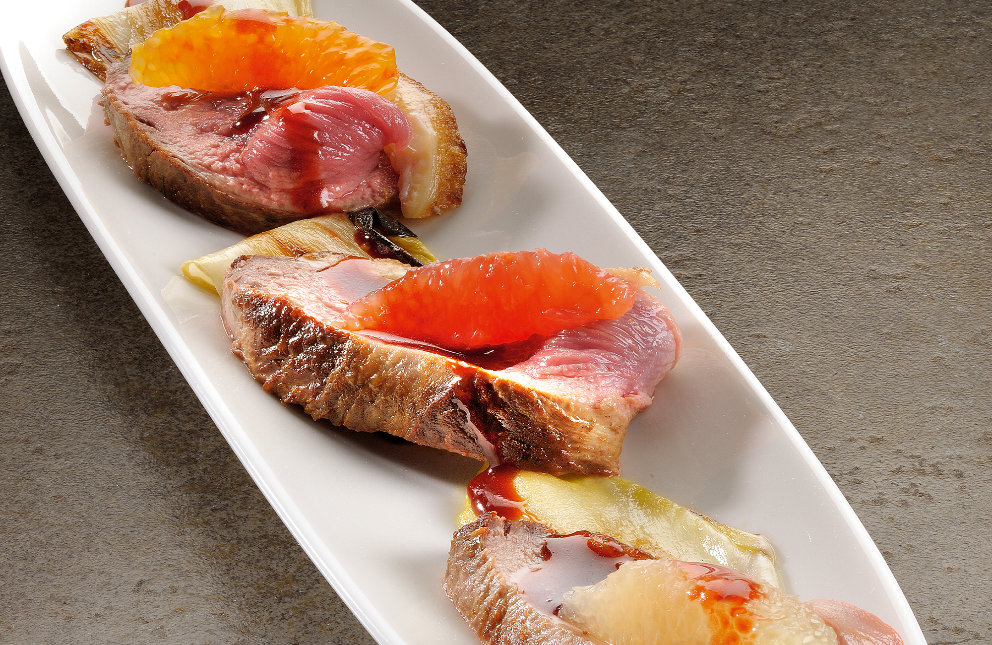 Duck fillet with citrus and belgian endive with vinaigrette based on Balsamic Vinegar of Modena P.G.I. - Ponti