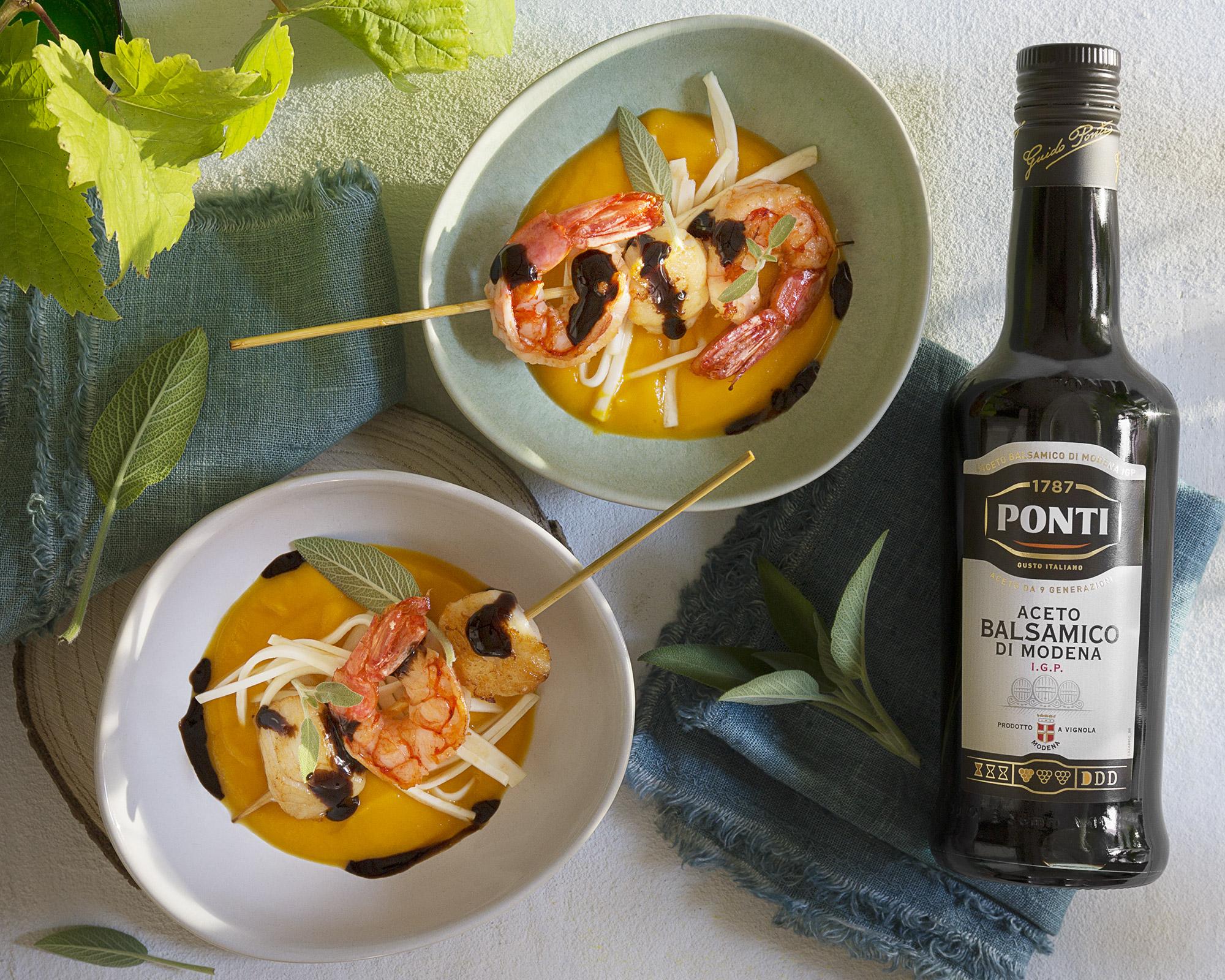 Spiedo di gamberi e capesante su crema di zucca sedano rapa arrostito e aceto balsamico - Ponti